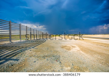 Landscape with troubled sky in the steppe - stock photo