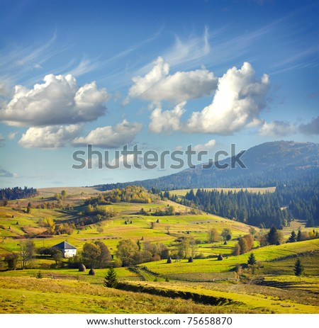 Landscape with village, mountains and blu sky - stock photo