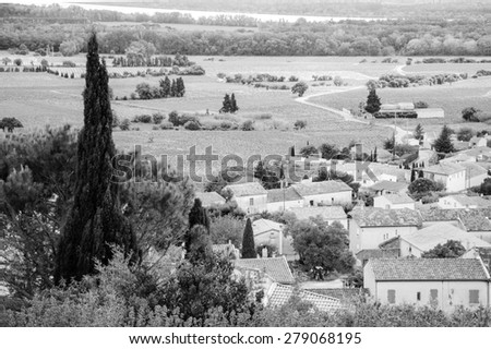 Landscape with vineyards and rural houses. A view from castle of Chateauneuf du Pape on the valley. Provence, France. Aged photo. Black and white. - stock photo