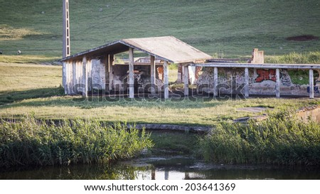 Landscape with waterline ruins, reeds and vegetation - stock photo