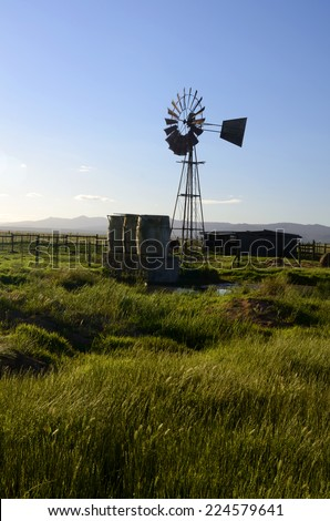 Landscape with windmill - stock photo