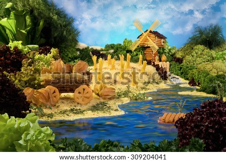 Landscape with windmill made from breadsticks, macaroni, snacks and others different foods. Handiwork. The image is made from multiple files.