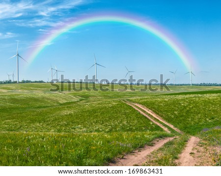 Landscape with windmills and rainbow - stock photo