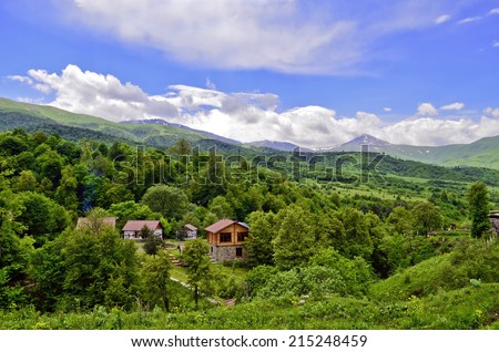 Landscape with wooden bower - stock photo