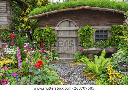 Landscaped backyard of a old house with flowering garden  - stock photo