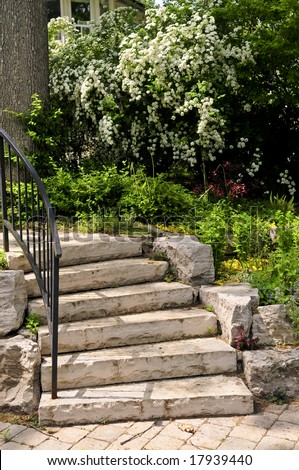 Landscaped front yard with natural stone steps - stock photo