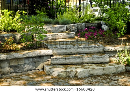 Landscaped front yard with natural stone steps and walkway - stock photo