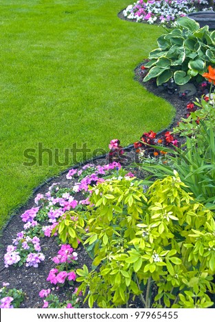 Landscaped Yard and Garden. A beautiful landscaped yard and garden with a variety of perennials and annuals. - stock photo