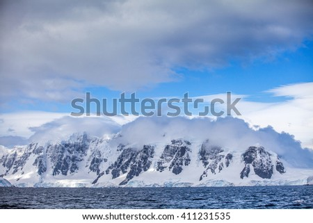 Landscapes Antarctica beautiful snow-capped mountains against the blue sky - stock photo