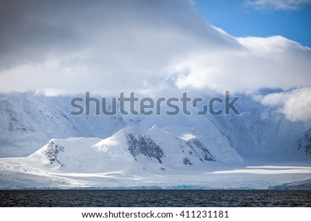 Landscapes Antarctica beautiful snow-capped mountains against the cloud sky - stock photo