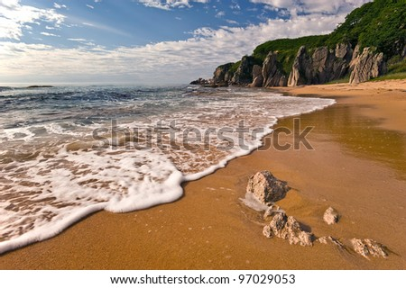 Landscapes of beautiful coastline with the incident wave. - stock photo