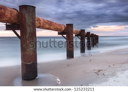 Landscapes of Poland. Sunset at Baltic sea. Industrial area. Pollution threat. - stock photo