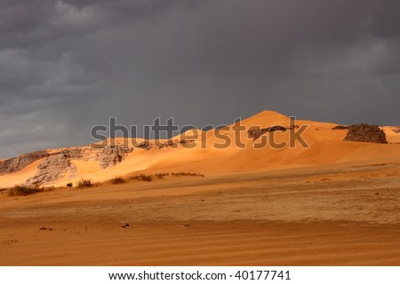 Landscapes of rocks and dunes in the algerian Sahara