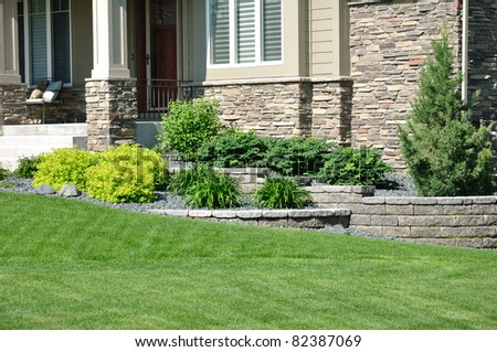 Landscaping and Retaining Wall at a Residential Home - stock photo