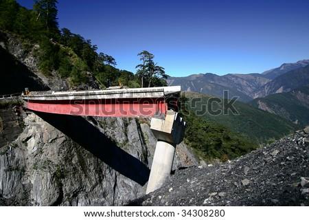 landslide Broken the bridge - stock photo