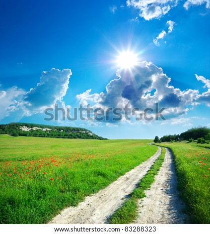 Lane in meadow and deep blue sky. Nature design. - stock photo