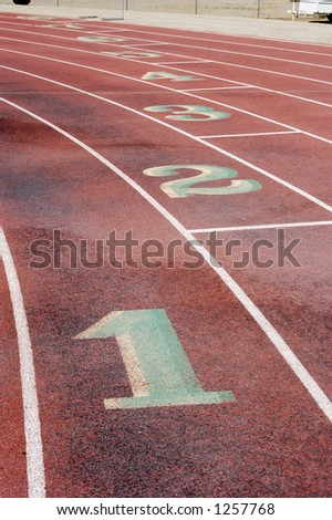 Lane markings at a wet running track.