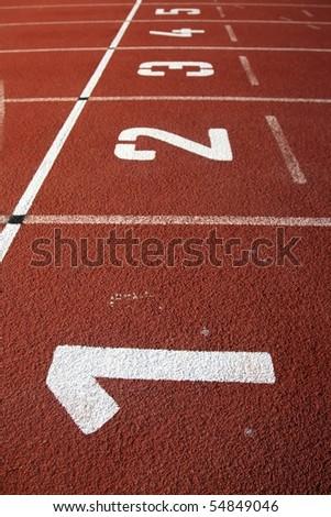 Lane numbers on a athletics tartan track - stock photo