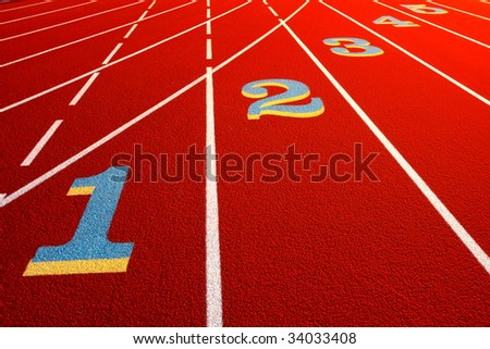 Lane numbers painted on an athletic stadium race track