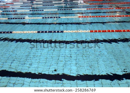 Lane swimming races in the huge Olympic swimming pool - stock photo