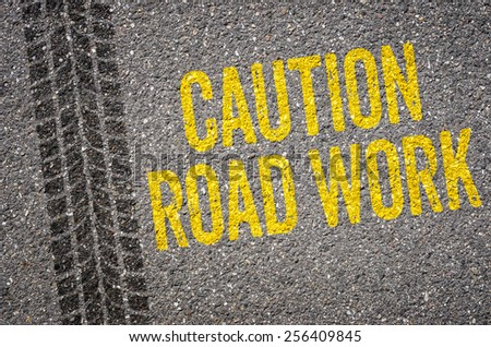 Lane with the text Caution Road work - stock photo