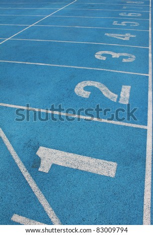 Lanes of a blue race track with numbers - stock photo