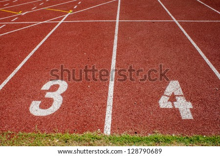 Lanes of a red race track with numbers