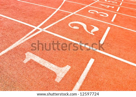 lanes of a running track in a olympic stadium - stock photo