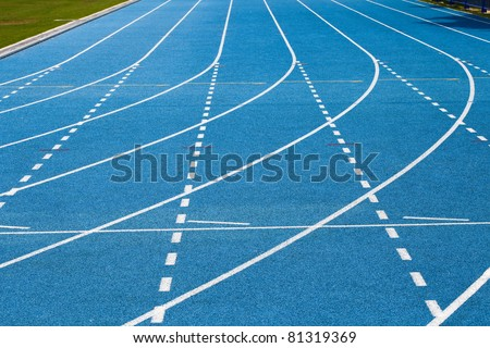 Lanes of blue running track - stock photo