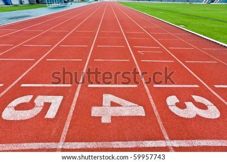 lanes of running track - stock photo