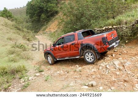Lang Son, Viet Nam - Nov 4, 2014: Ford Ranger Wildtrak crossing on bad road in Vietnam - stock photo