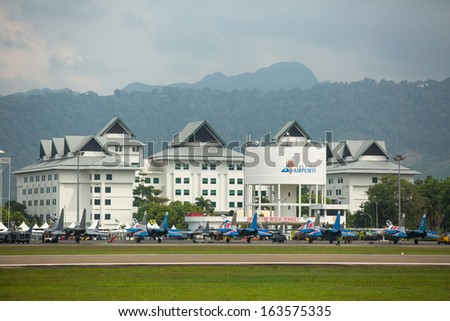 LANGKAWI, MALAYSIA - MAR 27: Malaysian Airports during on LIMA'13 - Langkawi International Maritime & Aerospace Exhibition on Mar 27, 2013 in Langkawi, Malaysia.  - stock photo