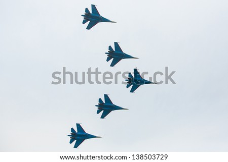 LANGKAWI, MALAYSIA - MAR 26: Russian Air Force Aerobatic Team Russian Knights performing during on LIMA13 Langkawi International Maritime & Aerospace Exhibition on Mar 26, 2013 in Langkawi, Malaysia. - stock photo