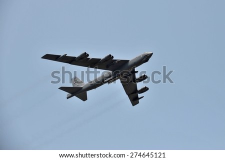 LANGKAWI, MALAYSIA - MARCH 17: Boeing B-52H 60-0010/LA from United States Air Force (USAF) crossing the airport in LIMA 2015 at Langkawi Malaysia on 17 March, 2015  - stock photo