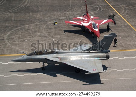 LANGKAWI, MALAYSIA - MARCH 16: Dassault Rafale and F16 Aircraft display in LIMA 2015 at Langkawi Malaysia on 16 March, 2015 - stock photo