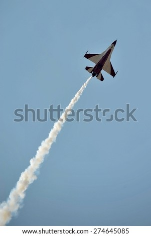 LANGKAWI, MALAYSIA - MARCH 18: Singapore Aerobatic Team display the show with F-16 aircraft in LIMA 2015 at Langkawi Malaysia on 18 March, 2015 - stock photo