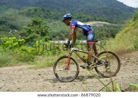 LANGKAWI, MALAYSIA - OCTOBER 18: An unidentified athlete participates in the Langkawi International Mountain Bike Challenge on October 18, 2011 in Langkawi, Malaysia. It is a 5-day stage race, from Oct. 18-22, 2011.