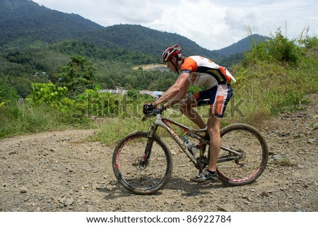 LANGKAWI, MALAYSIA - OCTOBER 18:An unidentified athlete participates in the Langkawi International Mountain Bike Challenge on Oct.18, 2011 in Langkawi,Malaysia. It is a 5-day stage race, from Oct.18-22,2011