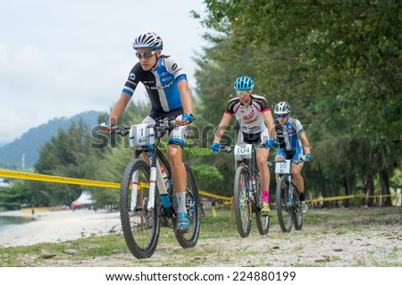 LANGKAWI, MALAYSIA - 18 OCTOBER 2014:  Fabian Giger(front) of Giant Pro XC team in action at Tradewinds LIMBC 2014 on October 18, 2014.  - stock photo