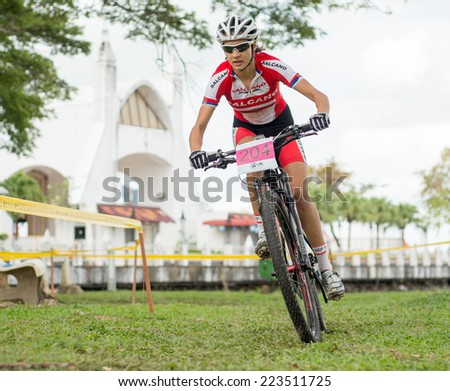 LANGKAWI, MALAYSIA - 13 OCTOBER 2014:  Jovana Crnogorac of team Serbia National in action during Prologue - Individual time trial at Tradewinds LIMBC 2014 on October 13, 2014.  - stock photo