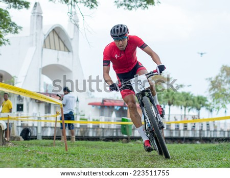 LANGKAWI, MALAYSIA - 13 OCTOBER 2014:  Kohei Yamamoto of team Specialized Racing in action during Prologue - Individual time trial at Tradewinds LIMBC 2014 on October 13, 2014.  - stock photo