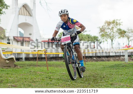 LANGKAWI, MALAYSIA - 13 OCTOBER 2014:  Masziyaton Mohd Radzi of team Kedah State in action during Prologue - Individual time trial at Tradewinds LIMBC 2014 on October 13, 2014.  - stock photo