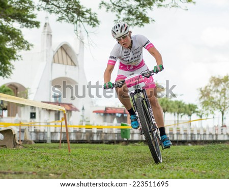 LANGKAWI, MALAYSIA - 13 OCTOBER 2014:  Nathalie Schneitter of team Colnago Sudtirol in action during Prologue - Individual time trial at Tradewinds LIMBC 2014 on October 13, 2014.  - stock photo