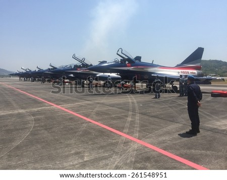 LANGKAWI - MARCH 17: Chinese aerobatic team readies for airshow at the Langkawi International Maritime and Aerospace (LIMA) exhibition in Langkawi March 17, 2015 - stock photo