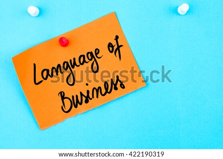 Language Of Business written on orange paper note pinned on cork board with white thumbtack, copy space available - stock photo