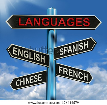 Languages Signpost Meaning English Chinese Spanish And French - stock photo
