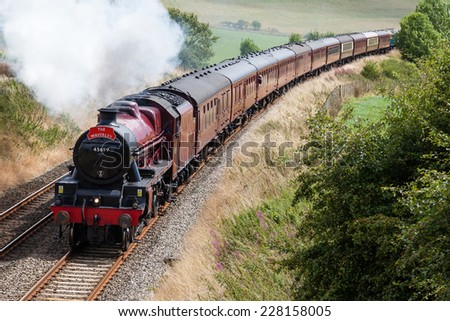 LANGWATHBY, ENGLAND - AUGUST 17: Preserved steam locomotive Galatea heads the Waverley south of Langwathby, England on August 17, 2014, on the Settle to Carlisle railway. - stock photo