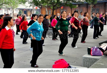 Langzhong Ancient City, China - October 22, 2013:  A group of Chinese women enjoy an afternoon dancing in unisom at one of the city's open plazas - stock photo
