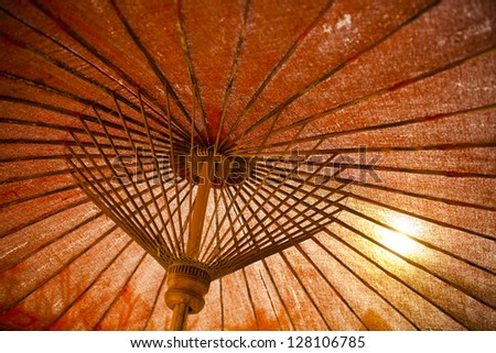 Lanna works bamboo and woods orange umbrella showing core texture details - stock photo