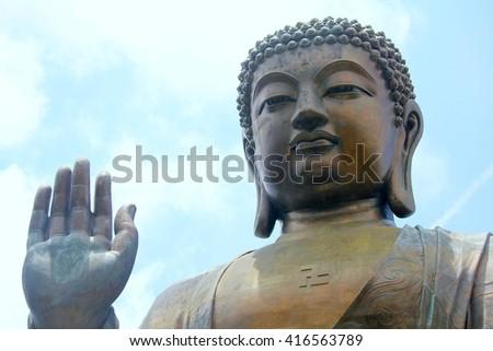 Lantau Buddha with palm facing out  - stock photo